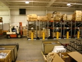 forklift accessing bulk storage on mobilized pallet racks in warehouse