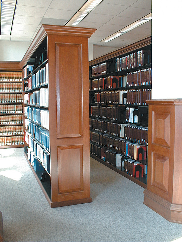 Wood Paneled Library: Cantilever Book Shelves