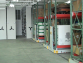 Mobilized compact racks in warehouse