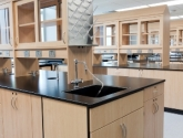 laboratory casework and cabinetry with drying rack and sink