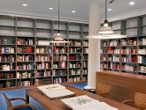 Tall Library Shelving for Book Storage along Wall