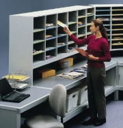 Woman Sorting Mail in Mail Room Sorter Furniture