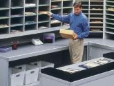 Man Sorting Mail into Mailroom Sorter Furniture