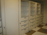 Empty Rotary Storage Cabinet with Drawers and Shelving